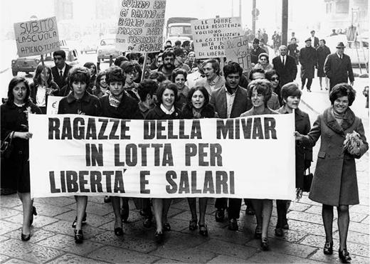 "Rally by women workers at the Mivar consumer electronics plant in Milan, 1969. Their banner reads: ""Mivar girls striking for freedom and salaries."" Archivio del lavoro, Milan, Fondo Silvestre Loconsolo."